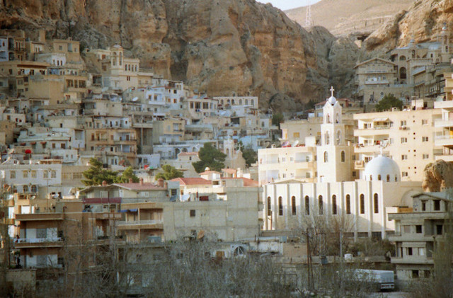 The hillside village of Maalula, where Aramaic, the language of Jesus, is still spoken. Both Christian and Muslim pilgrims pray together at Ma'lula's two monasteries.